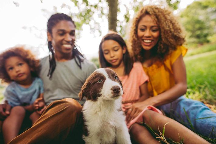 A FAMILY-THEIR DOG POSE FOR A HAPPY PICTURE FOR THE PET-FRIENDLY VAN MARK APARTMENTS IN MONROE, LA