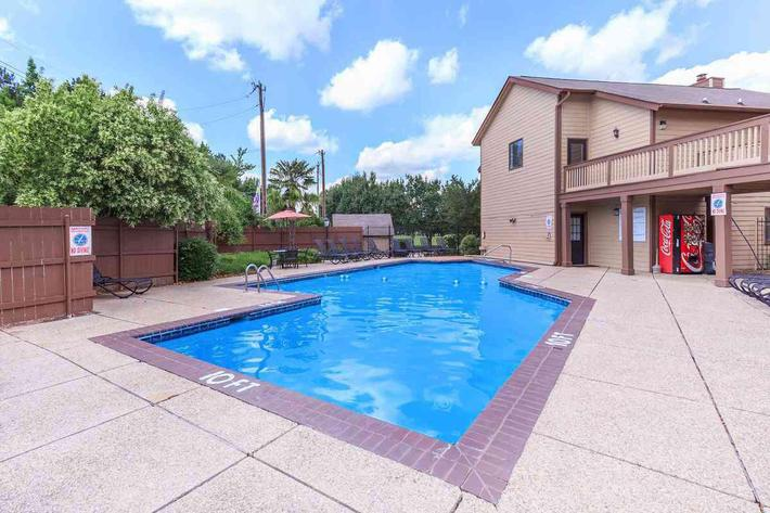 THE 10-FEET DEEP SWIMMING POOL AWAITS RESIDENT SWIMMERS ON A SUNNY SUMMER DAY AT VAN MARK APARTMENTS IN MONROE, LA