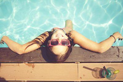 girl relaxing at pool.jpg