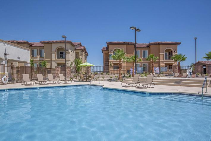 RELAX BESIDE OUR LAGOON STYLE POOL AT JARDIN GARDENS IN NORTH LAS VEGAS