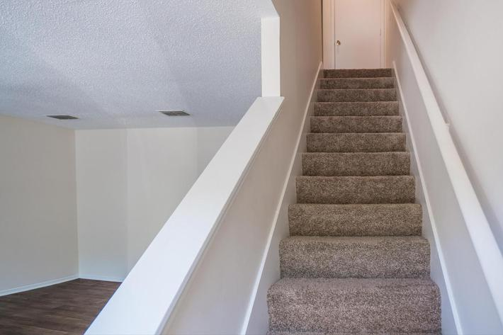 Stair Case in Three Bedroom Apartment at Willow Pointe in Antioch