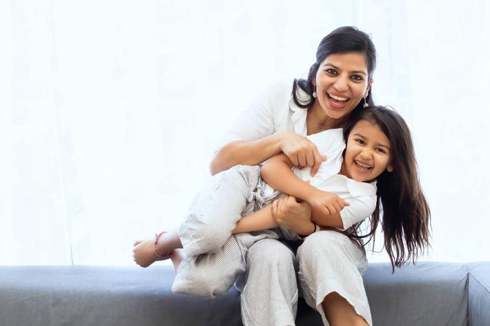 diverse mom and child white background.jpg
