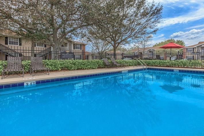 Soak up the sun in our shimmering swimming pool at Lakeland Landing in Lakeland, Florida.