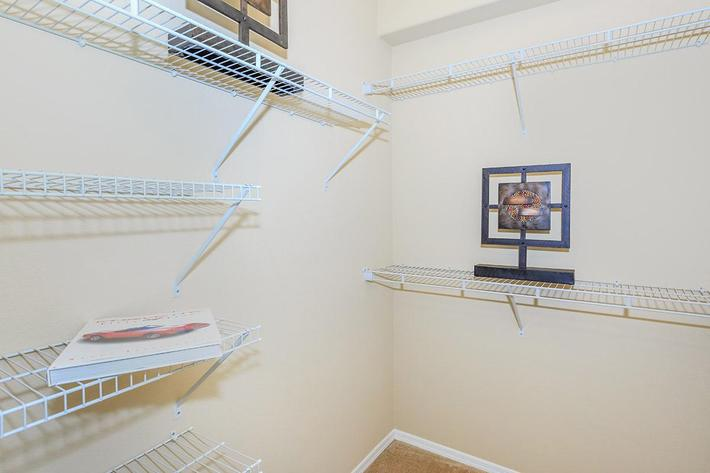 Large Walk-in Closets with Built-in Shelving at The Paseo Apartments in Goodyear, Arizona