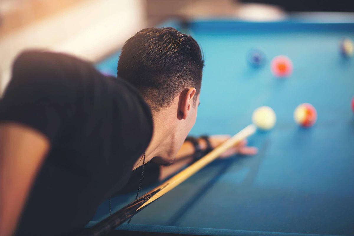 Copy of man playing pool iStock-636188860.jpg