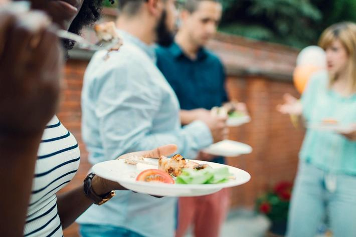 Unrecognizable People Eating At Barbecue Party iStock-474522384.jpg