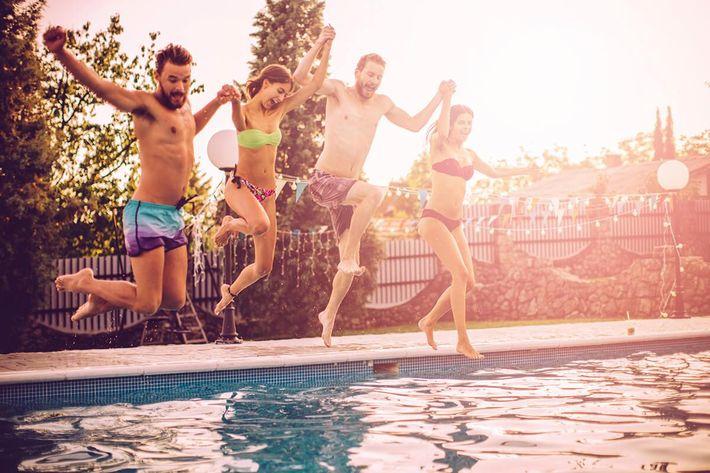 amenities-pool-friends jumping in.jpg