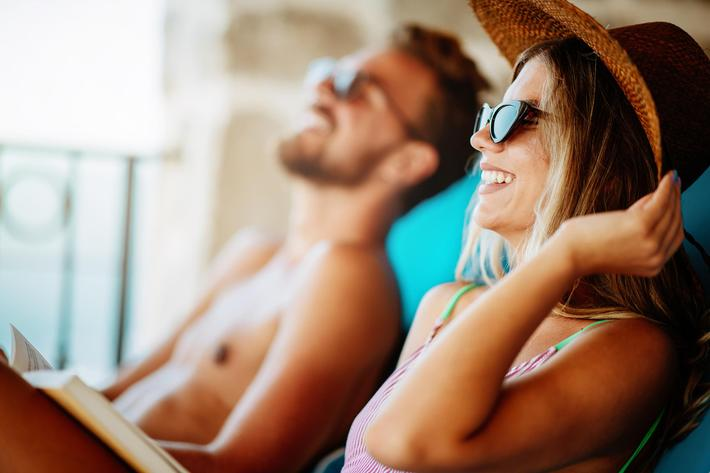 Couple-Poolsode-Lounging-Relaxing_Pool-1155517042.jpg