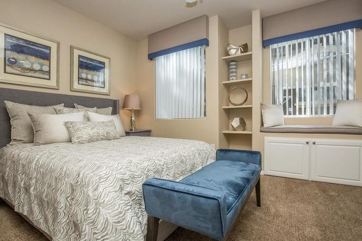 COMFORTABLE BEDROOM INCLUDES A WINDOW SEAT WITH STORAGE