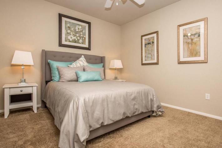 COMFORTABLE BEDROOM AT THE FAIRWAYS AT SOUTHERN HIGHLANDS APARTMENTS