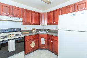 a kitchen with a red refrigerator and a stove