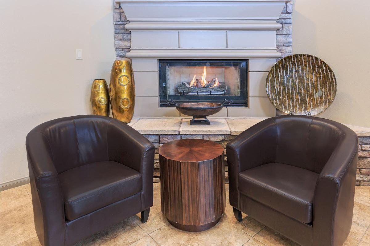 Catch Up with Friends Next to a Cozy Fire at The Equestrian on Eastern Apartments