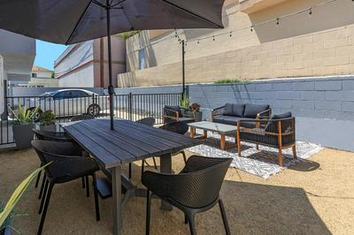 Enjoy our barbecue area here at Flats on Elk that has seating and umbrellas to shade you.