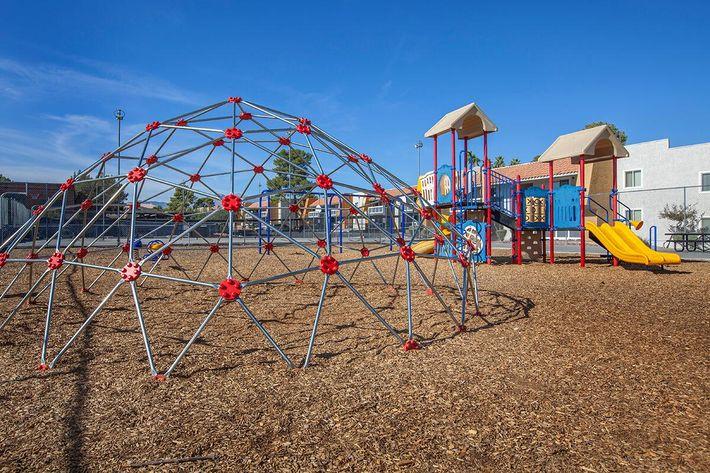 SUNDANCE VILLAGE APARTMENTS HAS A CHILDREN'S PLAY AREA