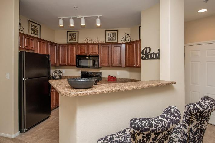 The Signature Gourmet Kitchen with Breakfast Bar