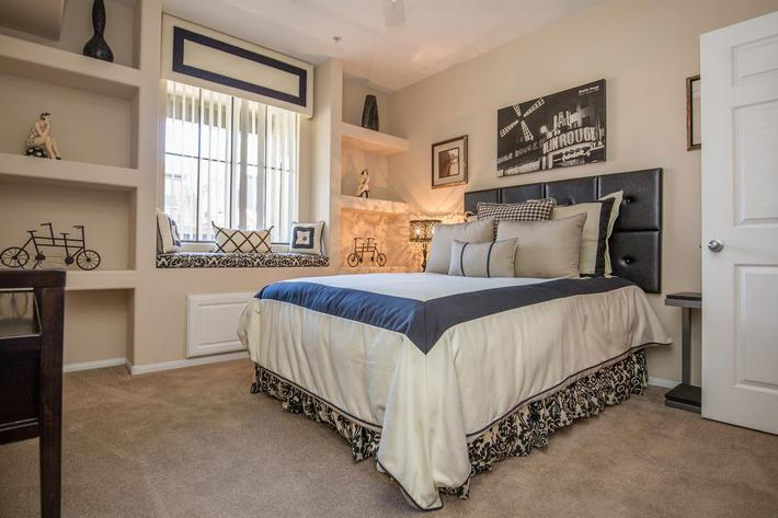 The Signatures Elegant Bedroom at The Passage Apartments in Henderson, NV