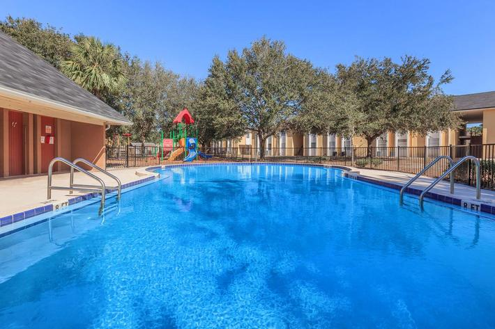 Kick back pool side here at Riverview Apartments in Jacksonville, Florida
