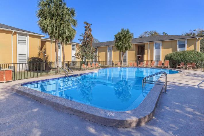 Relax pool side here at Riverview Apartments in Jacksonville, Florida