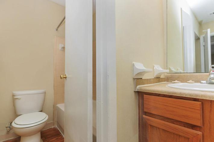 Two bedroom sleek bathroom here at Riverview Apartments in Jacksonville, Florida