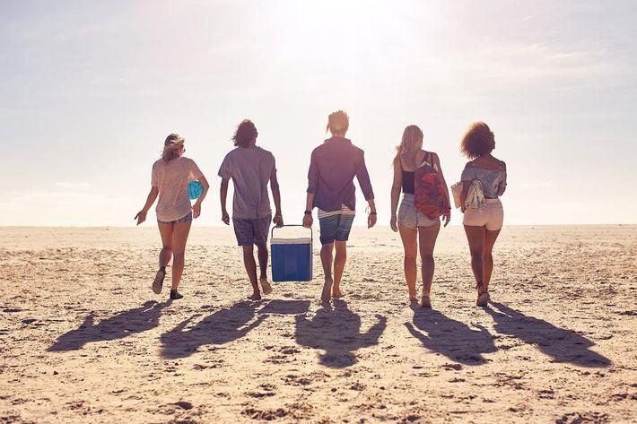 Friends walking on the beach.jpg