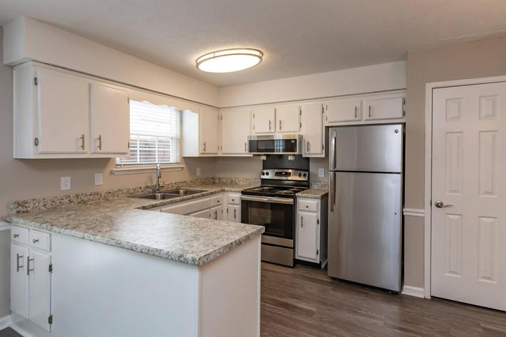 Open kitchen at British Woods Apartments