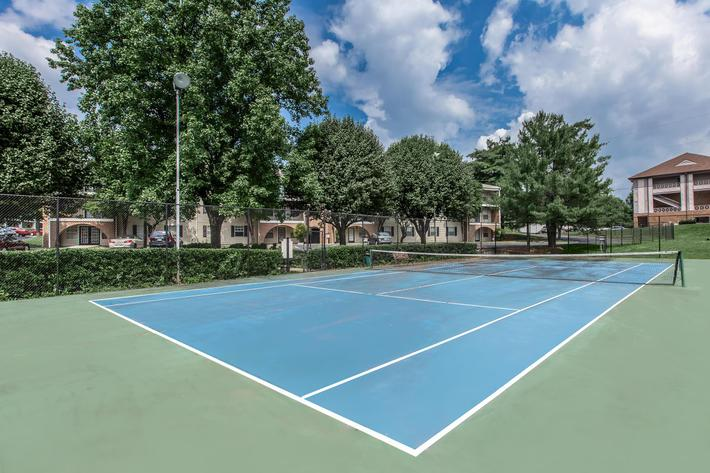 Lighted tennis court at British Woods Apartments