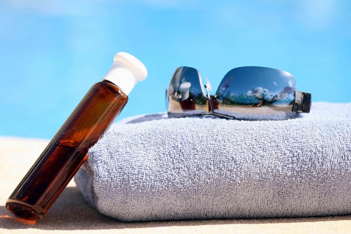 lotion-towel-sunglasses iStock_000005942652Large.jpg