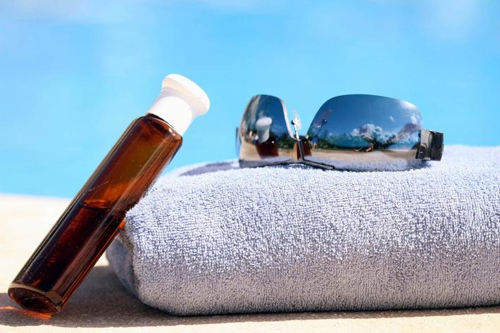 lotion-towel-sunglasses iStock_000005942652Large.jpg