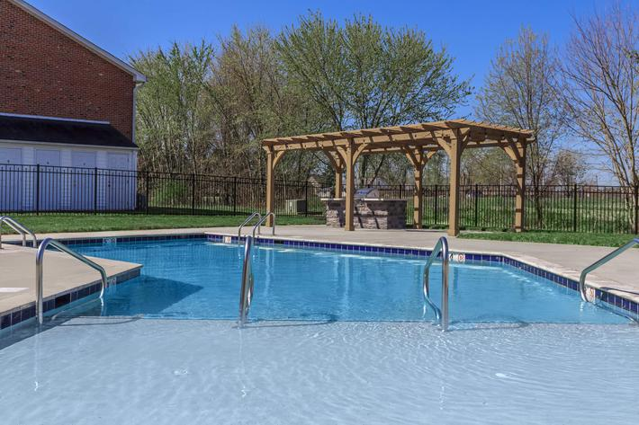 Relax poolside at Summertrees Apartments