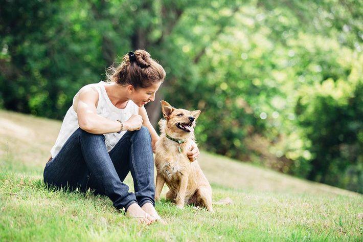 Adult Woman Enjoying Time with Pet Dog.jpg