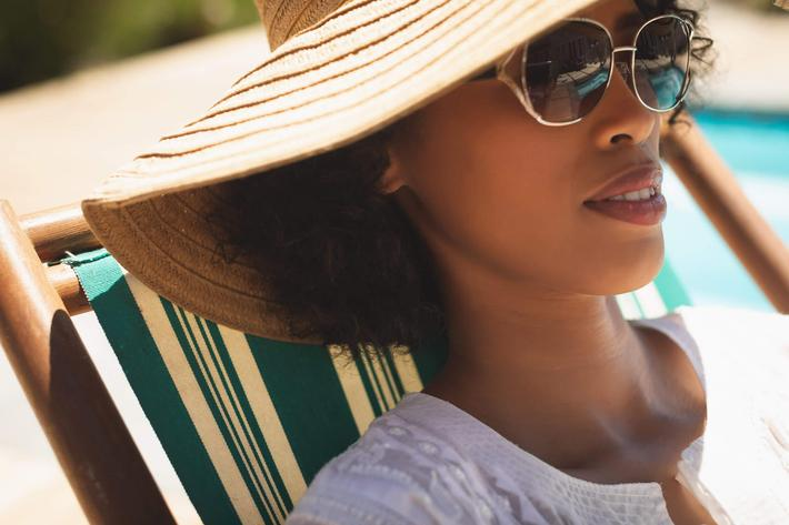 lady by the pool in hat.jpg