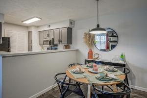 a kitchen area with a desk and chair in a room