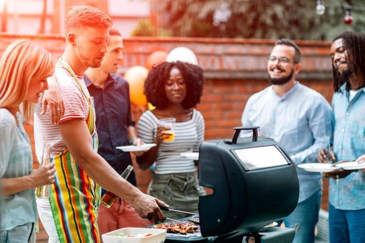 Barbecue with Friends at Bluff View at Northside Apartments