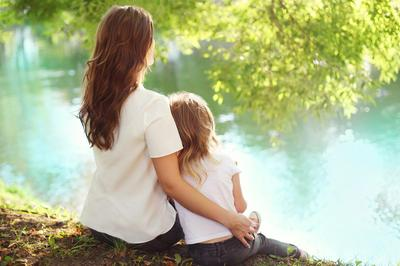 mom and daughter by pond .jpg