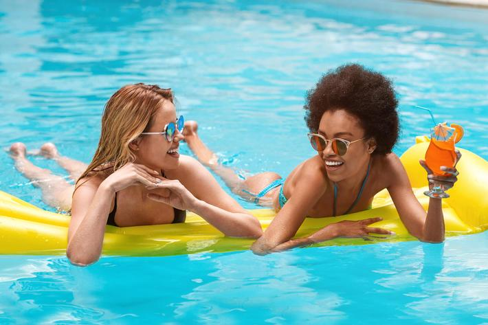 Diverse women in pool -1256669172.jpg