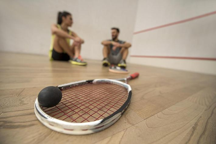 Close up of squash racket and a ball iStock_86260647_LARGE.jpg