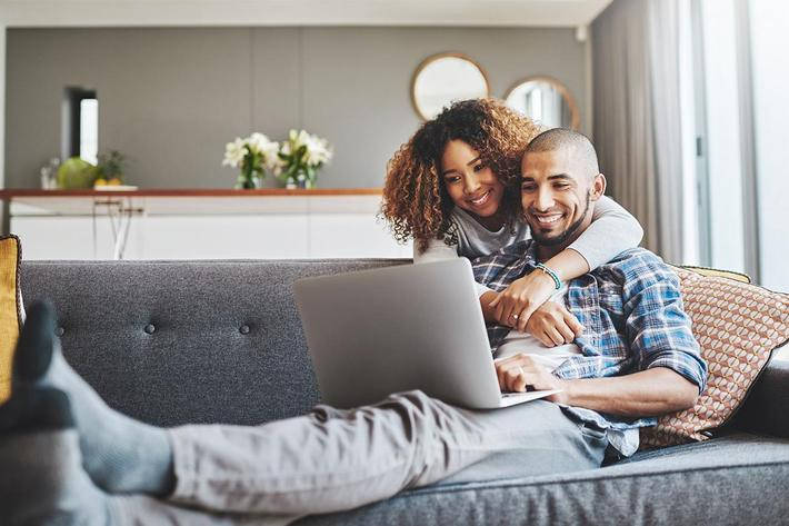 couple on couch - iStock-905523732.jpg