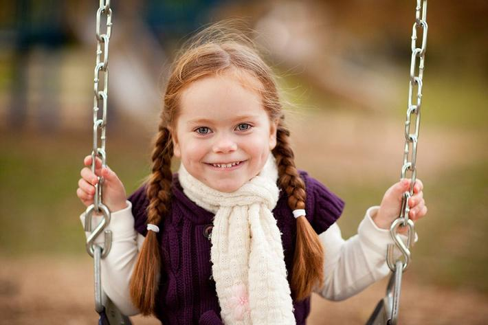 amenities-playground-girlonswing.jpg