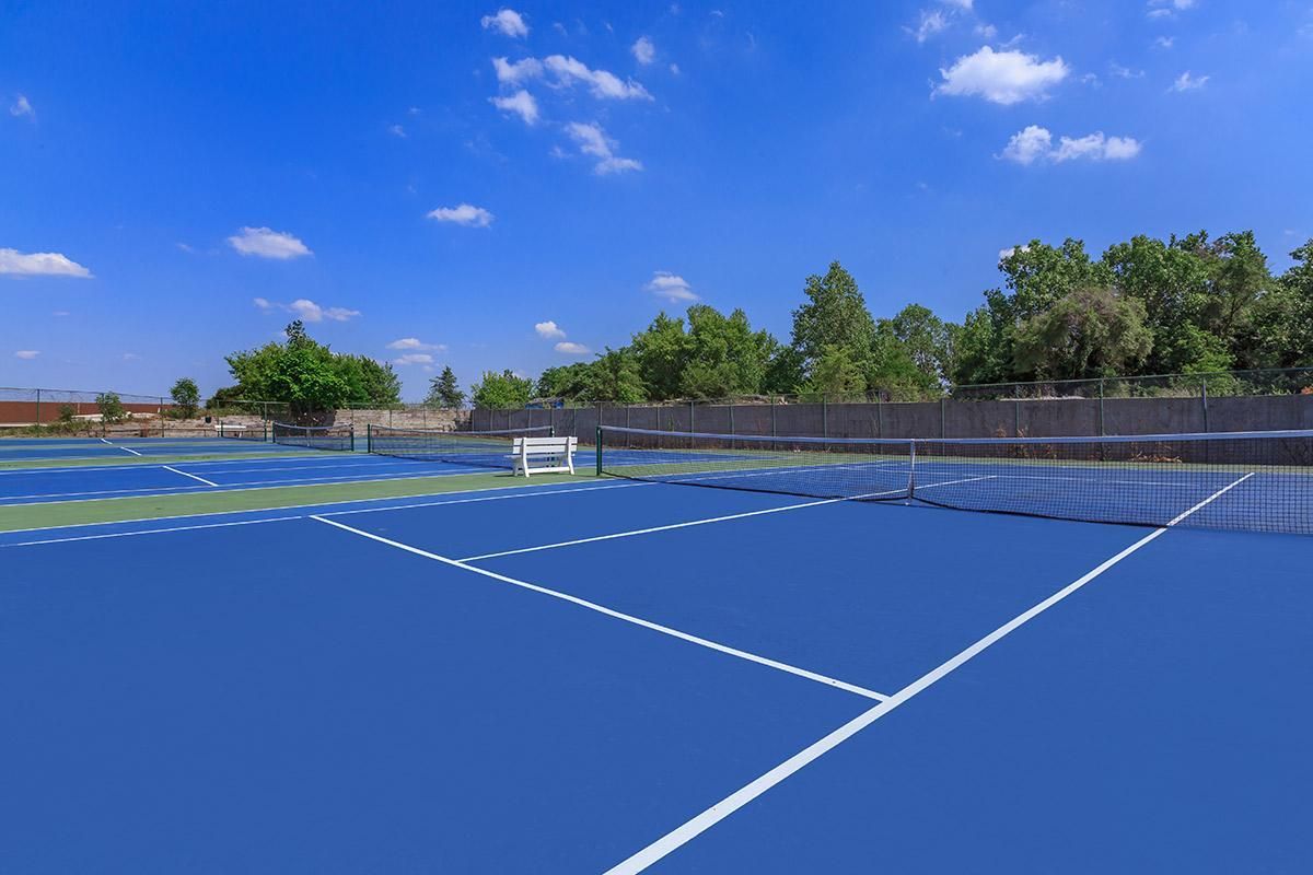 EIGHT TENNIS COURTS