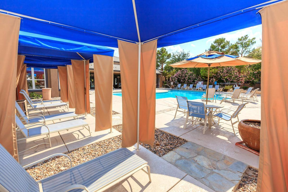 Lounging by the pool at Pinehurst Condominiums Luxury Rentals