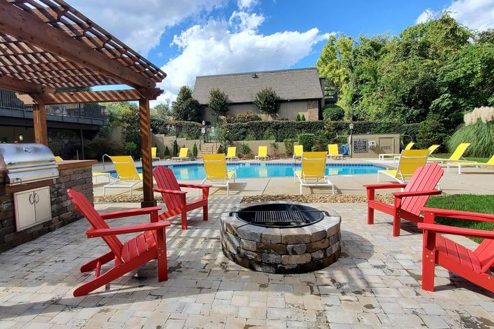 Sit poolside at Kingston Pointe Apartments