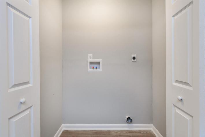 Washer and dryer connections at Kingston Pointe Apartments
