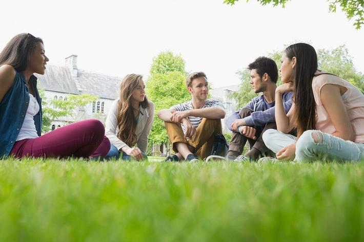students-exterior-group-sitting.jpg