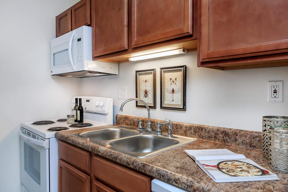a kitchen with a stove a sink and a microwave