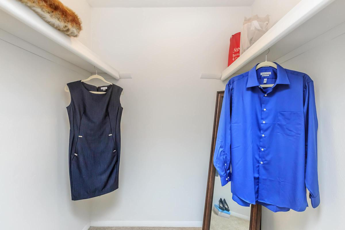 a pair of clothes hanging on a wall