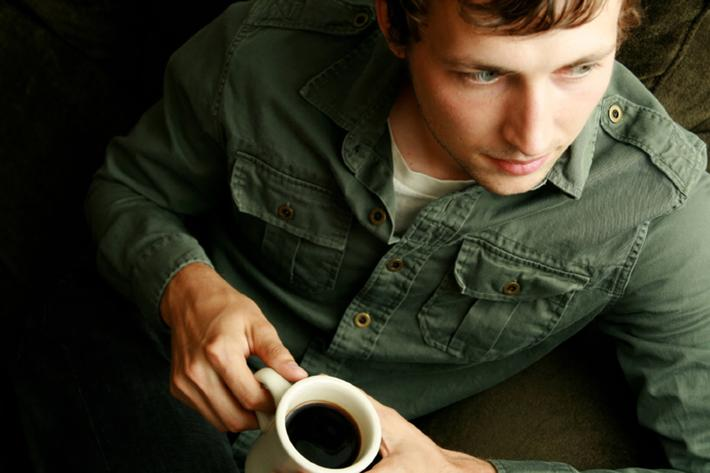 A man enjoying a cup of coffee
