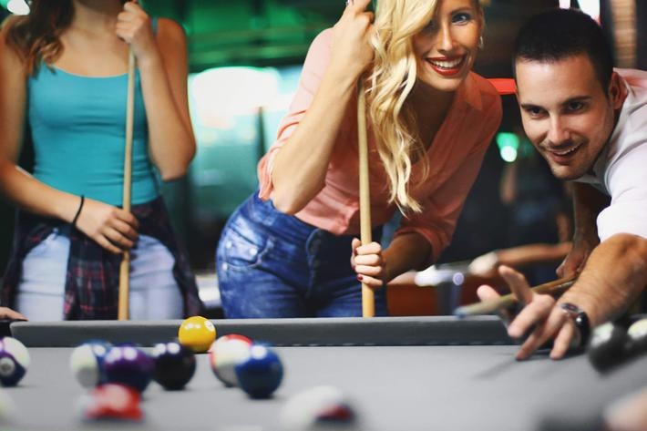 Friends shooting pool. iStock-623620156.jpg