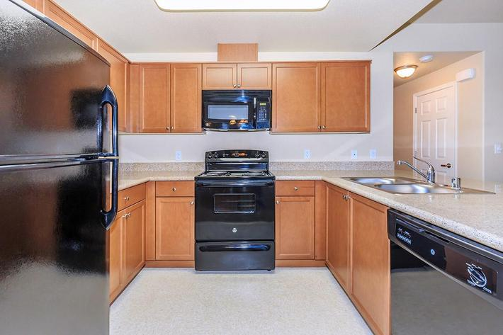 Enjoy the sleek black appliances in the kitchens at Boulder Creek