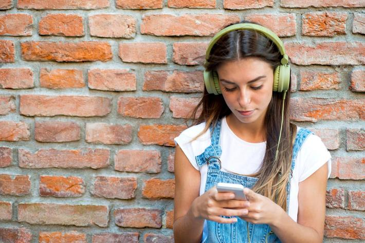Young Woman Lstening to Music iStock_000069575391_Large.jpg