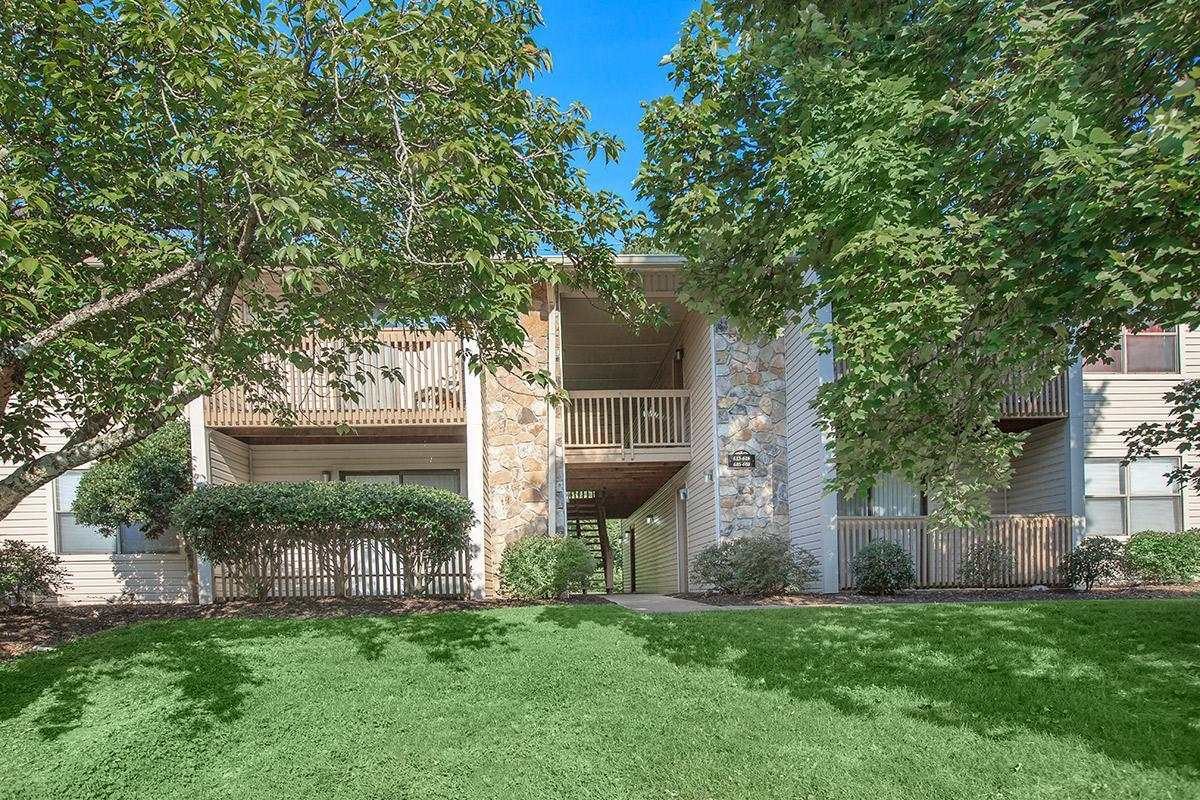 Mature trees and lovely landscaping surrounds Laurel Ridge Apartments